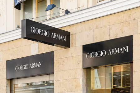 haute couture: VIENNA, AUSTRIA - AUGUST 15, 2015: Giorgio Armani is an Italian fashion house founded by Giorgio Armani which designs and manufactures haute couture, leather goods, shoes, watches and jewelry. Editorial