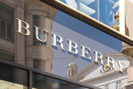 outerwear: VIENNA, AUSTRIA - AUGUST 15, 2015: Founded in 1856 Burberry Group is a British luxury fashion house, distributing outerwear, fashion accessories, fragrances, sunglasses, and cosmetics.