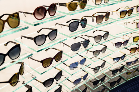 shop window display: VIENNA, AUSTRIA - AUGUST 15, 2015: Luxury Sunglasses For Sale In Shop Window Display.