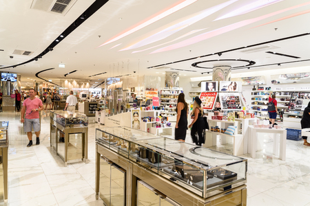 shopping mall interior: VIENNA, AUSTRIA - AUGUST 15, 2015: Women Searching For Luxury Perfume In Shopping Mall Interior.