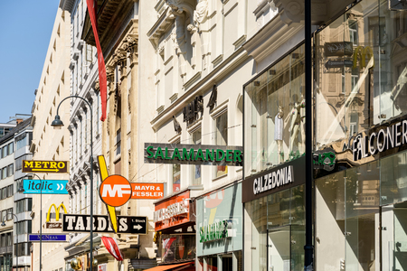 display advertising: VIENNA, AUSTRIA - AUGUST 15, 2015: Famous Clothing Brands Advertising On Karntnerstrasse Street, One Of The Most Busiest Streets In Downtown Vienna City.