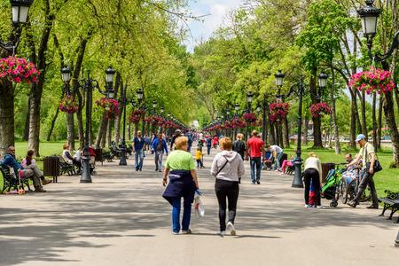 hot day: BUCHAREST, ROMANIA - AUGUST 10, 2015: People Taking A Walk On Hot Summer Day In Mogosoaia Public Park.