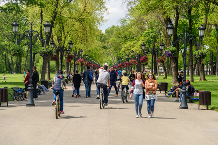 walk in: BUCHAREST, ROMANIA - AUGUST 10, 2015: People Taking A Walk On Hot Summer Day In Mogosoaia Public Park.