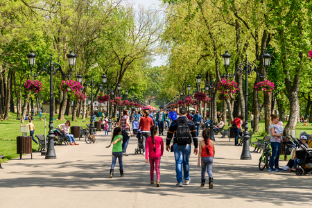 walk in the park: BUCHAREST, ROMANIA - AUGUST 10, 2015: People Taking A Walk On Hot Summer Day In Mogosoaia Public Park.