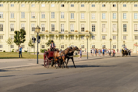 hofburg: VIENNA, AUSTRIA - AUGUST 20, 2015: Horses and Classic Carriage Transport at Hofburg Palace the former imperial palace in the centre of Vienna. Editorial