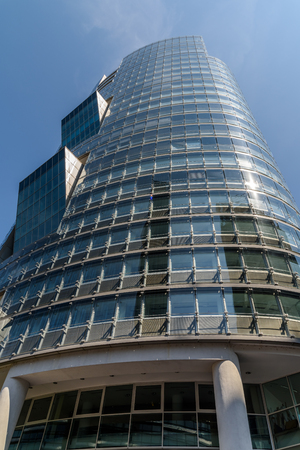 andromeda: VIENNA, AUSTRIA - AUGUST 20, 2015: Unisys Andromeda Tower Skyscraper In Donaucity District Of Vienna City. Unisys is an American global information technology that provides IT services and software.