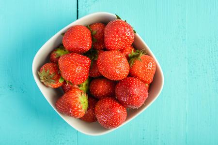 strawberry: Strawberry Bowl On Blue Background Stock Photo