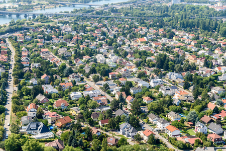 suburbia: VIENNA, AUSTRIA - AUGUST 25, 2015: Aerial View Of Suburbs Houses Roofs In Vienna City From Donauturm Danube Tower One Of The Tallest Towers In Vienna. Editorial