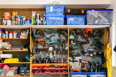 pegboard: BUCHAREST, ROMANIA - NOVEMBER 30, 2015: Assortment Of Tools In Tool Shed Workshop.