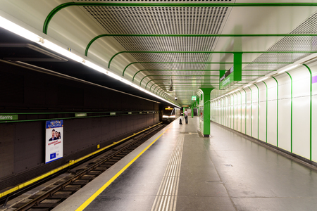subway station: VIENNA, AUSTRIA - AUGUST 28, 2015: People Waiting For Train In Subway Station In Downtown Vienna.