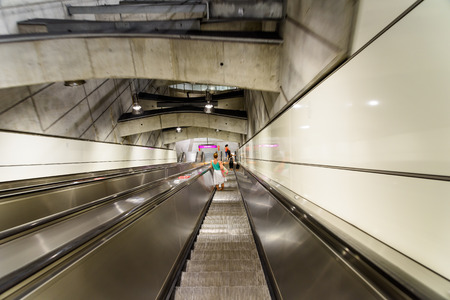 subway station: VIENNA, AUSTRIA - AUGUST 28, 2015: People Traveling On Escalator To Train Subway Station In Downtown Vienna.