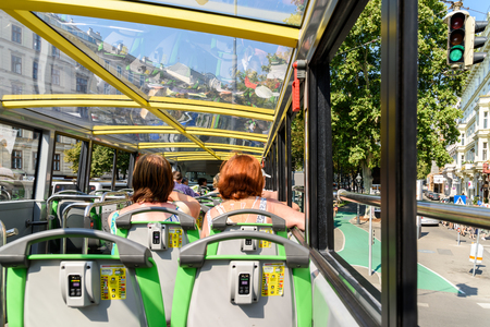 tour bus: VIENNA, AUSTRIA - AUGUST 25, 2015: Vienna Hop On Hop Off City Tour Bus offers tourists visiting Vienna a complete tour of the most important landmarks in the city. Editorial