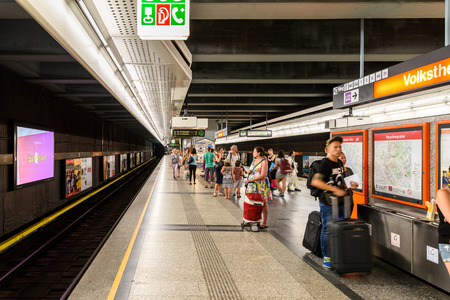 subway station: VIENNA, AUSTRIA - AUGUST 29, 2015: People Waiting For Train In Subway Station In Downtown Vienna.