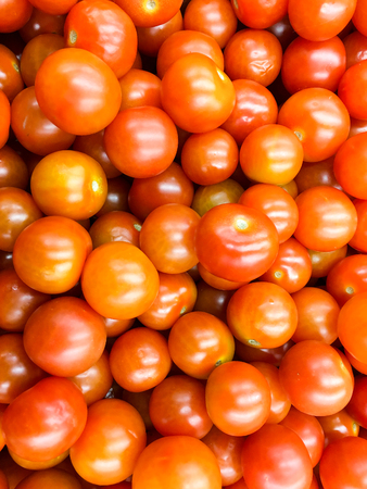 vegetable market: Red Cherry Tomatoes Group For Sale In Vegetable Market