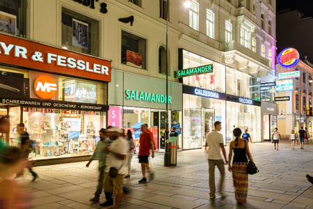 important people: VIENNA, AUSTRIA - AUGUST 25, 2015: People Shopping On Graben Street In The Night, One Of The Most Famous Shopping Streets And Important Promenades In Viennas City Centre.