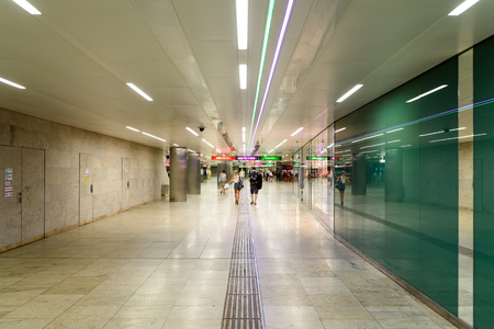 public transfer: VIENNA, AUSTRIA - AUGUST 28, 2015: People Waking In Tunnel Underground Metro For Subway Station Transfer. Editorial