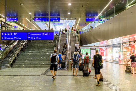 public transfer: VIENNA, AUSTRIA - AUGUST 28, 2015: People Waking In Large Metro Station For Subway Transfer. Editorial