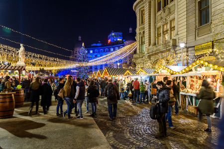 BUCHAREST, ROMANIA - DECEMBER 24, 2015:  Christmas Market Downtown Bucharest City At Night In The University Square.