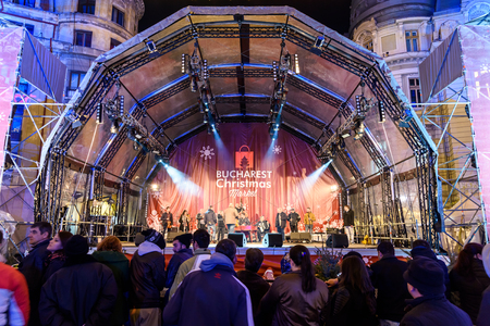 BUCHAREST, ROMANIA - DECEMBER 24, 2015:  People Gather At The Christmas Market Free Concert Downtown Bucharest City At Night In The University Square.