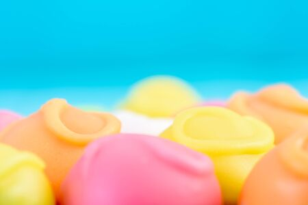 macro texture: Fondant Candies On Turquoise Background