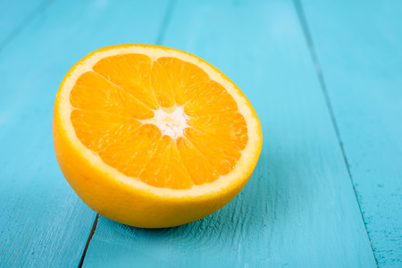 orange slice: Fresh Orange Slice On Turquoise Background