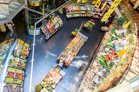 lifestyle shopping: VIENNA, AUSTRIA - AUGUST 08, 2015: People Shopping For Grocery Food In Supermarket Store Aisle.