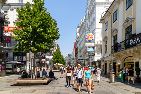 people street: VIENNA, AUSTRIA - AUGUST 08, 2015: People Visiting And Shopping On Karntner Street, One Of The Most Famous Shopping Streets And Important Promenades In Viennas City Centre.