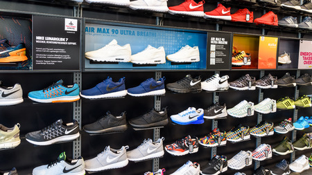 nike: VIENNA, AUSTRIA - AUGUST 08, 2015: Nike Running Shoes For Sale In Nike Shoe Store Display.