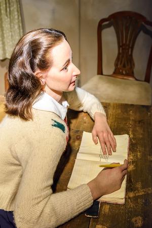 anne: VIENNA, AUSTRIA - AUGUST 08, 2015: Anne Frank Figurine At Madame Tussauds Wax Museum. Editorial
