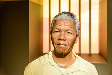 prison: VIENNA, AUSTRIA - AUGUST 08, 2015: Nelson Mandela Figurine At Madame Tussauds Wax Museum.
