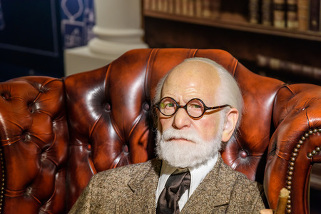 psychoanalysis: VIENNA, AUSTRIA - AUGUST 08, 2015: Sigmund Freud Figurine At Madame Tussauds Wax Museum.
