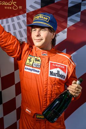 winner man: VIENNA, AUSTRIA - AUGUST 08, 2015: Gerhard Berger Figurine At Madame Tussauds Wax Museum.