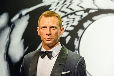 VIENNA, AUSTRIA - AUGUST 08, 2015: Daniel Craig Figurine At Madame Tussauds Wax Museum. 報道画像