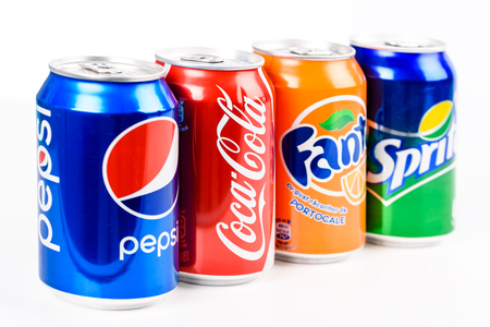 drinking soda: BUCHAREST, ROMANIA - JANUARY 16, 2016: Pepsi, Coca Cola, Sprite And Fanta are the most famous carbonated soft drinks sold in stores, restaurants, and vending machines all around the world.