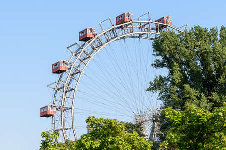 Fun Park Ferris Wheel Against Blue Sky In Vienna Prater Park