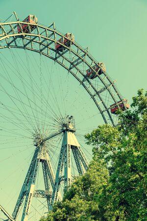 prater: Retro Filter Of Fun Park Ferris Wheel Against Blue Sky In Vienna Prater Park Stock Photo
