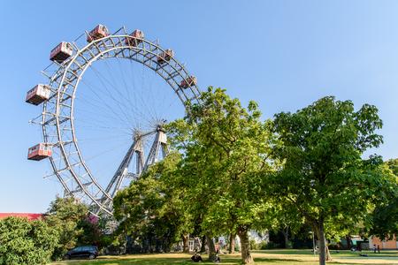 prater: VIENNA, AUSTRIA - AUGUST 09, 2015: The Wurstelprater amusement park or Prater stands in one corner of the Wiener Prater and includes the Wiener Riesenrad.