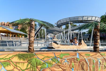prater: VIENNA, AUSTRIA - AUGUST 09, 2015: People Having Fun On Roller Coaster Ride In Wurstelprater Amusement Park or Prater In Vienna.
