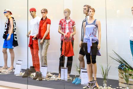 shop display: VIENNA, AUSTRIA - AUGUST 10, 2015: Boutique Fashion Mannequins Of Fashion Shop Display In Vienna City. Editorial