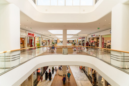 VIENNA, AUSTRIA - AUGUST 10, 2015: People Shop In Shopping City Sud Luxury Mall The Biggest Shopping Mall In Austria. 報道画像