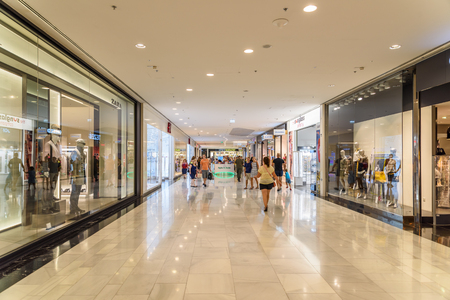 VIENNA, AUSTRIA - AUGUST 10, 2015: People Shop In Vienna Shopping City Luxury Mall.