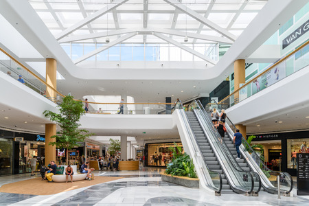 VIENNA, AUSTRIA - AUGUST 10, 2015: People Shop In Vienna Shopping City Luxury Mall.
