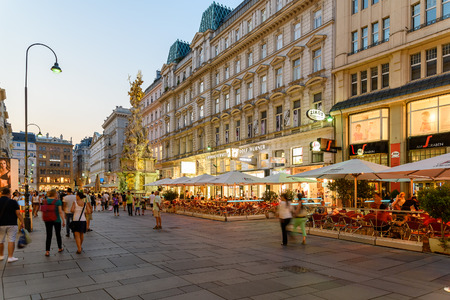 old time: VIENNA, AUSTRIA - AUGUST 10, 2015: People Shopping On Graben Street In The Night, One Of The Most Famous Shopping Streets And Important Promenades In Viennas City Centre.