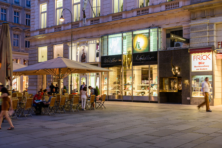 important people: VIENNA, AUSTRIA - AUGUST 10, 2015: People Shopping On Graben Street In The Night, One Of The Most Famous Shopping Streets And Important Promenades In Viennas City Centre.