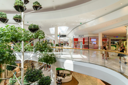shopping mall interior: VIENNA, AUSTRIA - AUGUST 11, 2015: People Shop In Vienna Shopping City Luxury Mall.