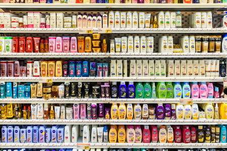 VIENNA, AUSTRIA - AUGUST 11, 2015: Shampoo Bottles For Sale On Supermarket Stand. 報道画像