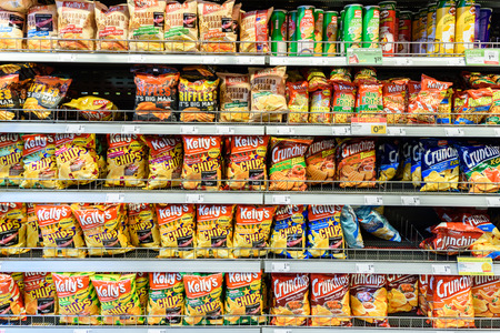 shopping binge: VIENNA, AUSTRIA - AUGUST 11, 2015: Fast Food Snacks For Sale On Supermarket Shelf.