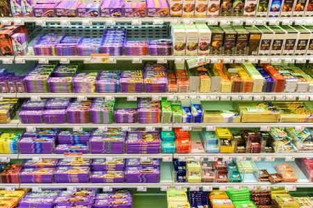 shelf: VIENNA, AUSTRIA - AUGUST 11, 2015: Chocolate Sweets For Sale On Supermarket Shelf. Editorial