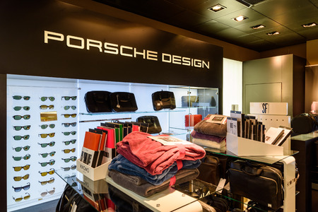 admirers: VIENNA, AUSTRIA - AUGUST 12, 2015: Porsche Design Group, based in Germany, was founded in November 2003 and sells clothes and accessories for Porsche admirers all over the world.