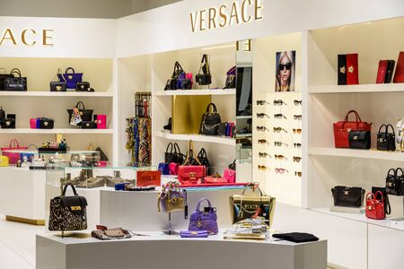 referred: VIENNA, AUSTRIA - AUGUST 12, 2015: Gianni Versace, usually referred to as Versace, is an Italian fashion company and trade name founded by Gianni Versace in 1978.
